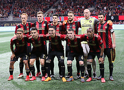 March 11, 2018 - Atlanta, GA, USA - The Atlanta United take the field for a team photo during their home opener against D.C. United on Sunday, March 11, 2018, in Atlanta, Ga. (Credit Image: © Curtis Compton/TNS via ZUMA Wire)