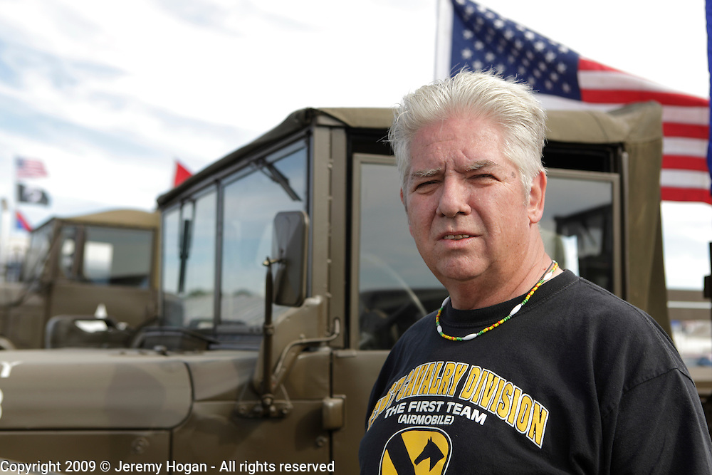 Bob Pugh was a crew chief in Hueys at Tay Nihn as part of the Bluelift in A Troop, 1st Squadron, 9th Cavalry during the Vietnam War. Pugh poses for a photo during a gathering in Kokomo, Indiana for the 2009 reunion.