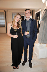 HELENA REA and SAM DOYLE of rock band The Maccabees at a dinner hosted by Harper's Bazaar to celebrate Browns 40th Anniversary in aid of Women International held at The Regent Penthouses & Lofts, 16-18 Marshall Street, London on 20th May 2010.