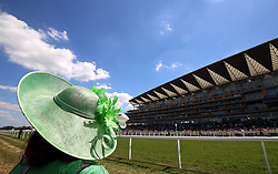 A racegoer awaits the action on the track during day four of Royal Ascot at Ascot Racecourse.