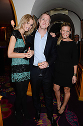 "Left to right, OLIVIA ""Bubble' PERRY, JAMIE RICHARDS and ANNA MACKINTOSH at a 1970's themed party as part of Annabel's 50th anniversary celebrations, held at Annabel's, Berkeley Square, London on 24th September 2013."