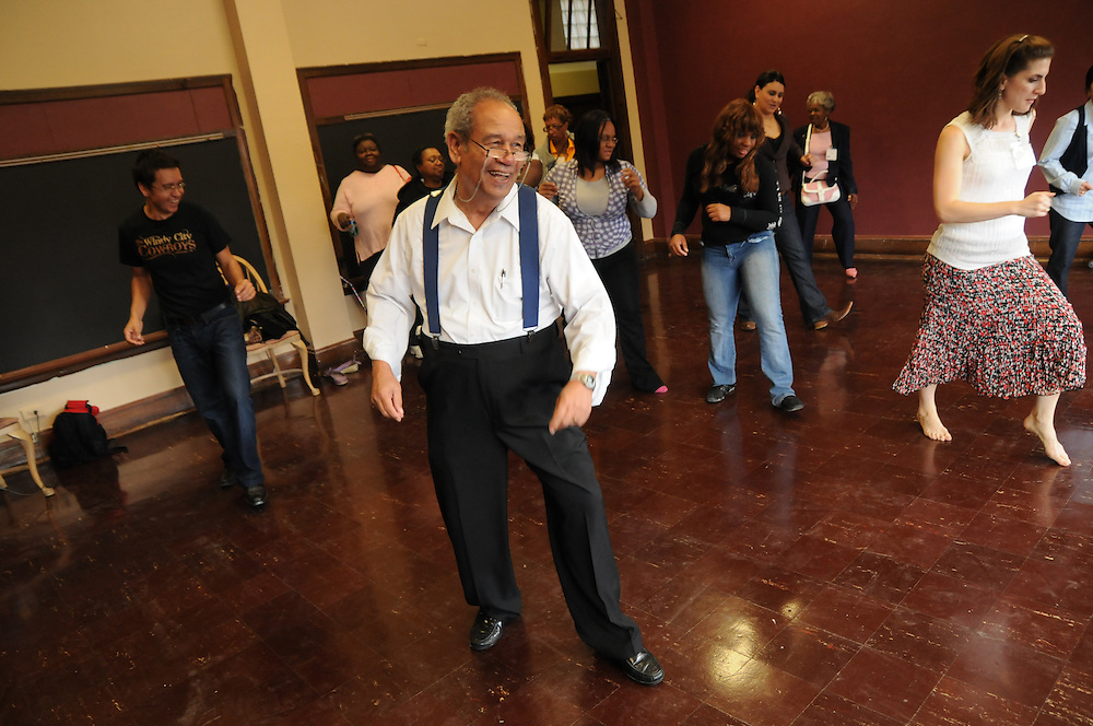 Line dance instructor Joe Johnson christens the Cesar Chavez Performing Arts Studio during an open house of the newly-inaugurated Quinn Community Center in Maywood. The project to revitalize the parish's former school building was undertaken by Pastor Carmelo Mendez, naming the center for former St. Eulalia Pastor William Quinn. Quinn made a lasting history for himself as a pioneer for social justice, both in the fields of civil rights, along with those of immigrants in the U.S. He died in 2004.