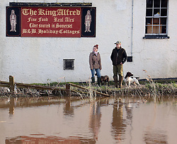 © Licensed to London News Pictures. 02/02/2014. Burrowbridge, UK Burrowbridge on the Somerset levels today. The River Parrett broke its banks again at 9.15 am today 2nd February 2014. Photo credit : Jason Bryant/LNP
