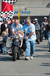 Kelly Modlin pushes his 1927 Henderson Deluxe over the finish line with his grandchild aboard at the end of Stage 16 (142 miles) of the Motorcycle Cannonball Cross-Country Endurance Run, which on this day ran from Yakima to Tacoma, WA, USA. Sunday, September 21, 2014.  Photography ©2014 Michael Lichter.