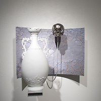 110414     Cayla Nimmo<br /> <br /> Brothers Jason and Jeff Hackett combine their photography work with ceramic work for their collaborative showcase at the Ingham Chapman Gallery at the University of New Mexico's Gallup campus.
