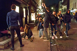 © Licensed to London News Pictures.  30/04/2021. London, UK. Members of the public make the most of Friday night out after pubs and restaurants closed in Soho, central London as as May bank holiday begins. Photo credit: Marcin Nowak/LNP