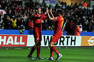 Gareth Bale of Wales celebrates with Hal Robson-Kanu after he scores opening goal from a penalty. FIFA World cup 2014 qualifier, group A , Wales v Croatia at the Liberty Stadium in Swansea, South Wales on Tuesday 26th March 2013. pic by Andrew Orchard, Andrew Orchard sports photography,