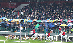 Members of the Kildare Hunt Club run out before the Kildare Hunt Club Fr Sean Breen Memorial Steeplechase for the Ladies Perpetual Cup during day one of the Punchestown Festival at Punchestown Racecourse, County Kildare, Ireland.