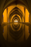 The Baths of Dona Maria de Padilla, a long vaulted hall underground beneath the Alcazar in Sevilla, Andalusia, Spain.