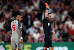 Michael Oliver shows a red card to Crystal Palace's Aaron Wan-Bissaka (not in picture) during the Premier League match at Selhurst Park, London.