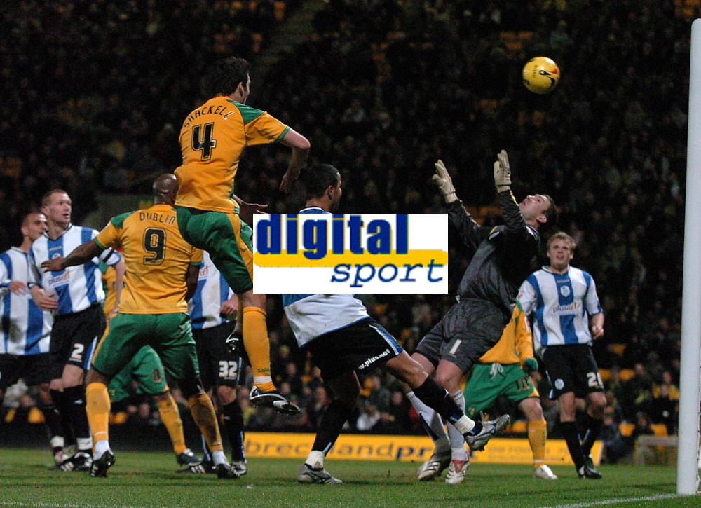 Photo: Ashley Pickering.<br />Norwich City v Sheffield Wednesday. Coca Cola Championship. 09/12/2006.<br />Dion Dublin (no. 9) lobs Sheffild goalie Mark Crossley with a header to score Norwich's only goal
