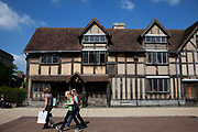 The birthplace of William Shakespeare in Stratford upon Avon, a small market town in the county of Warwickshire in central England. The town is a popular tourist destination owing to its status as birthplace of the playwright and poet William Shakespeare, receiving about three million visitors a year from all over the world.