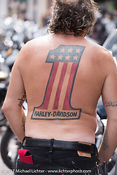 Mark Laske bares his number one Harley logo tattoo on Main Street in Deadwood during the annual Sturgis Black Hills Motorcycle Rally. Deadwood, SD, USA. Monday August 7, 2017.  Photography ©2017 Michael Lichter.