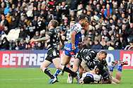 Hull FC centre Josh Griffin (4) and Hull FC prop forward Masi Matongo (19) bring a St Helens player down during the Betfred Super League match between Hull FC and St Helens RFC at Kingston Communications Stadium, Hull, United Kingdom on 16 February 2020.