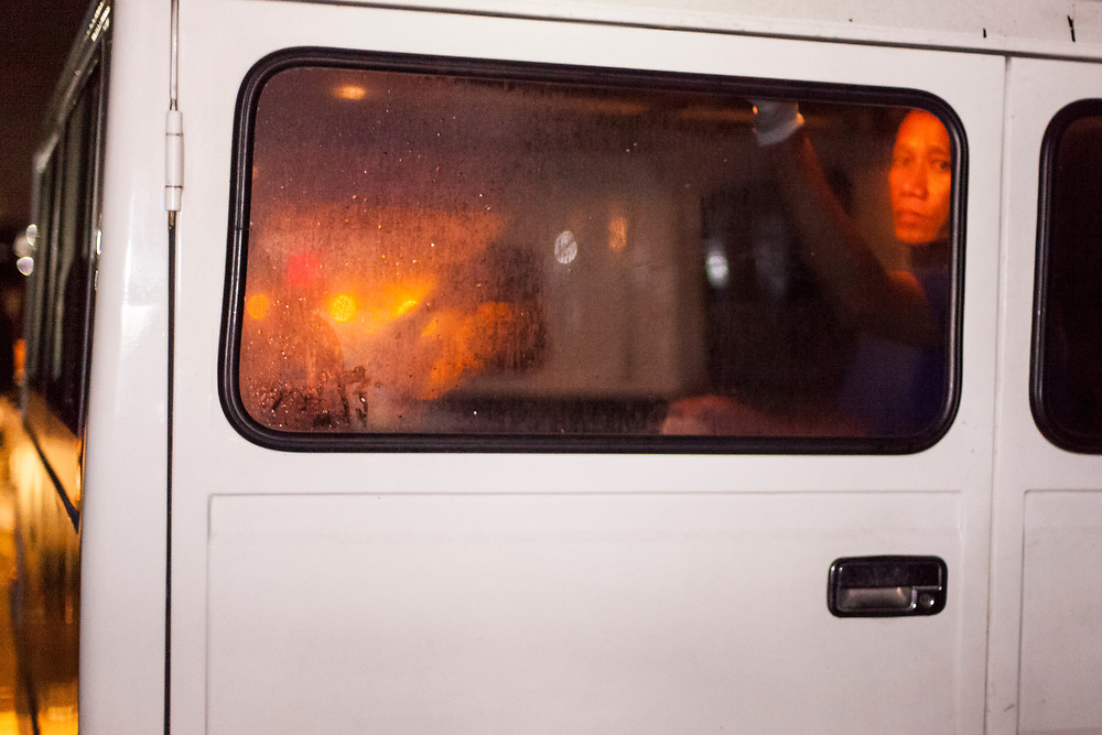 A worker from a morgue is seen inside a van on its way to take the dead body from the crime scene.<br /> <br /> Over 12 thousand people including men, women and even young teens who are mostly the urban poor, have been killed since President Duterte initiated the campaign against drugs. The killings or executions are carried out by masked gunmen. Bodies in morgue showed signs that the victims were bound or handcuffed but the police report often states they fought back or tried to run away.