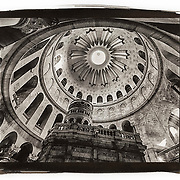 The interior of the Church of the Holy Sepulchre in the Old City of Jerusalem is illuminated by the light from the dome overhead.