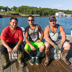 Sternmen Nick Hynd (left) and Michael Estes (center), with captain of 'Pontus' Jed Miller on the dock at the Tenants Harbor Fisherman's Coop in Tenants Harbor, Maine.