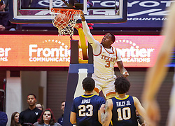 Feb 9, 2019; Morgantown, WV, USA; Texas Longhorns guard Courtney Ramey (3) dunks the ball during the second half against the West Virginia Mountaineers at WVU Coliseum. Mandatory Credit: Ben Queen-USA TODAY Sports