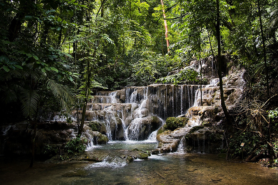 A waterfall flows down a series of natural terraced pools at the Mayan ruins of Palenque, Chiapas state, Mexico. The falls are known as the Queens' Bath, after the belief that the Mayan royalty used the pools for bathing.