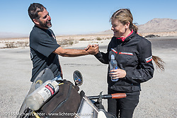Anthony Rutledge greets Cris Simmons at a stop in the desert during the Motorcycle Cannonball Race of the Century. Stage-14 ride from Lake Havasu CIty, AZ to Palm Desert, CA. USA. Saturday September 24, 2016. Photography ©2016 Michael Lichter.
