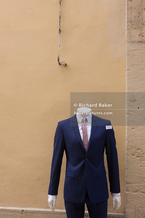 Male suit mannequin and overhead power wiring  in Montpellier, south of France.