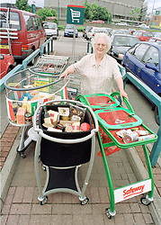 Freda Duckenfield from Pitsmoor trying out the shopping trolleys of the future at the Viva Italia Safeway Roadshow
