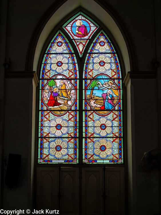 14 AUGUST 2014 - BANGKOK, THAILAND: A stained glass window at Holy Rosary Church in the Talat Noi section of Bangkok. Holy Rosary Church, Wat Mae Phra Luk Prakham, is also known as Kalawar Church. The church was built with a land grant from King Rama I in 1786, about four years after Bangkok was established as Siam's capital. Many Catholic Vietnamese and Cambodians fled to Bangkok during the wars in Indochina and adopted this church as their main house of worship. It has been rebuilt twice. The present church was built in the late 1890s. The cream-colored church has a towering spire and European style stained-glass windows.    PHOTO BY JACK KURTZ