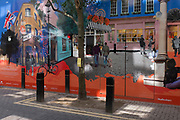 A construction hoarding of a new retail business, featuring everyday life in the Neal Street and Seven Dials area of the West End, on 2nd July 2020, in London, England.