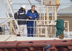 © Licensed to London News Pictures. 26/10/2020. Southampton, UK. Crew members stand on the deck of the oil tanker Nave Andromeda moored at the cruise terminal at Southampton. The Special Boat Service (SBS) raided the tanker yesterday evening off the Isle of Wight after stowaways were found on board who threatened the crew. Photo credit: Peter Macdiarmid/LNP