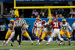 Joe Burrow #9 of the LSU Tigers drops back to pass during the first half against the Oklahoma Sooners in the 2019 College Football Playoff Semifinal at the Chick-fil-A Peach Bowl on Saturday, Dec. 28, in Atlanta. (Paul Abell via Abell Images for the Chick-fil-A Peach Bowl)