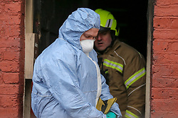 © Licensed to London News Pictures. 10/02/2020. London, UK. Forensic officer and firemen inside a property on Olinda Road, in Hackney, North London following a fire where a woman died. Police were called to Olinda Road at around midnight. According to the neighbours, the woman was in her 70s. Photo credit: Dinendra Haria/LNP