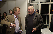 Martin Amis and Clive James. party for Anthony Lane's book hosted  given by David Remnick, editor of the New Yorker. River Cafe. 12 November 2002.  © Copyright Photograph by Dafydd Jones 66 Stockwell Park Rd. London SW9 0DA Tel 020 7733 0108 www.dafjones.com