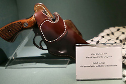 November 9, 2016 - Ramallah, West Bank, Palestinian Territory - A picture shows (Hattah and agal) and old personal pistol and holster of Yasser Arafat at the late Palestinian leader Yasser Arafat's Museum in the West Bank city of Ramallah on November 9, 2016. The Yasser Arafat Museum opened in Ramallah, shedding light on the long-time Palestinian leader's life and offering a glimpse of history -- along with a number of his trademark black-and-white keffiyehs  (Credit Image: © Shadi Hatem/APA Images via ZUMA Wire)