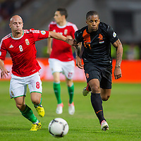Hungary's Jozsef Varga (L) and Netherlands' Jeremain Lens (R) fight for the ball during a World Cup 2014 qualifying soccer match Hungary playing against Netherlands in Budapest, Hungary on September 11, 2012. ATTILA VOLGYI
