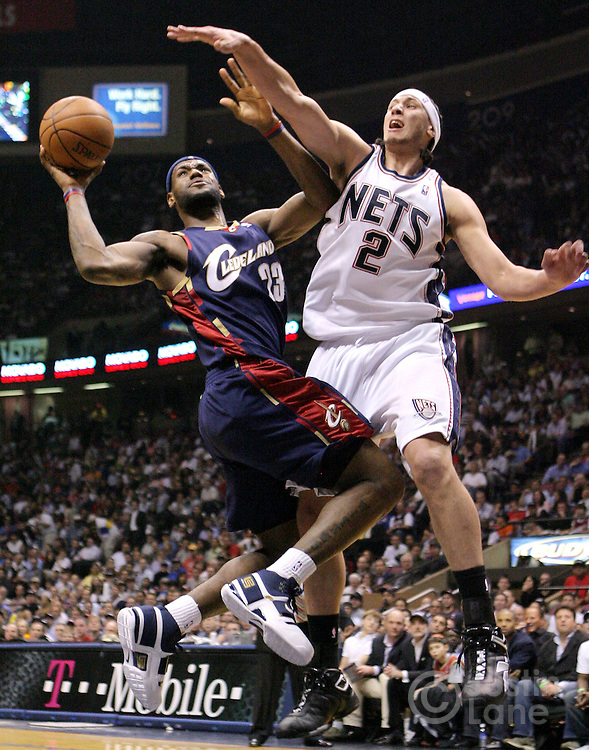 Cavaliers' LeBron James (L) shoots past the Nets' Josh Boone (R)during game 4 of the Eastern conference semifinals at Continental Airlines Arena in East Rutherford, New Jersey on 14 May 2007.