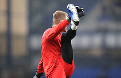 Liverpool goalkeeper Simon Mignolet warming up ahead of the Premier League match at Goodison Park, Liverpool.
