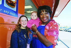 While promoting the McCaine ROSTI roadshow  by demonstrating a few of her own recipies, celebrity cook Rusty Lee, takes time to meet and have her photograph taken with fans Sam Kidby and 18 Monthold Jordan during her visit to Asda at Handsworth in Sheffield on Tuesday morning Oct 11 2001