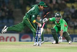 © Licensed to London News Pictures. 25/09/2012. Bangladesh batsmen Tamim Iqbal is run out by Pakistan fielder Mohammad Hafeez during the T20 Cricket World T20 match between Pakistan Vs Bangladesh at the Pallekele International Stadium Cricket Stadium, Pallekele. Photo credit : Asanka Brendon Ratnayake/LNP