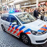 NLD/Amsterdam/20150701 - Filmpremiere Magic Mike XXL, politie rijdt met hoge snelheid door de menigte