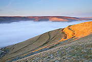 The ancient fortifications of Mam Tor catch the evening light