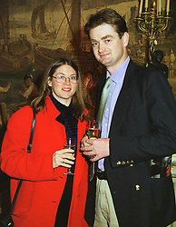 MR RUPERT ULOTH and his fiancee LADY LOUISA GUINNESS at a reception in London on 22nd March 1999.MPO 1