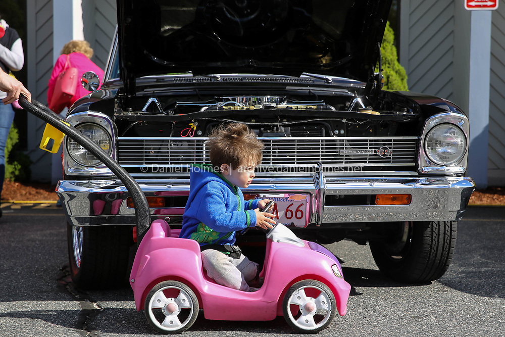 (5/7/17, ASHLAND, MA) Foster Abram, 2, of Newton, speeds by a 1966 Chevrolet Nova during the All Vehicle Show and Spring Automotive Open House at the MassBay Automotive Technology Center in Ashland on Sunday. [Daily News and Wicked Local Photo/Dan Holmes]