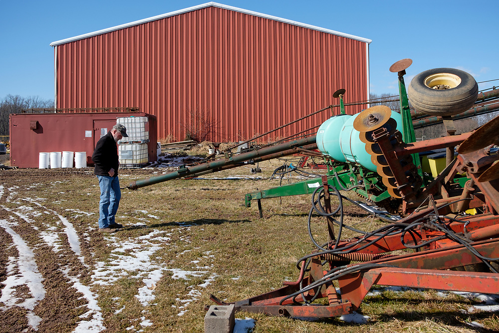 Farmer Mike Mathews walks past equipment that will be auctioned off on Feb. 15, 2019, in Pittstown, New Jersey.