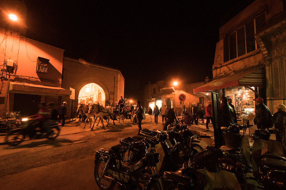 """Marrakesh or Marrakech or Meṛṛakec, is a major city of Morocco. It is the fourth largest city in the country, after Casablanca, Rabat and Fes. It is the capital city of the mid-southwestern region of Marrakesh-Asfi. Located to the north of the foothills of the snow-capped Atlas Mountains. Marrakesh is possibly the most important of Morocco's four former imperial cities (cities that were built by Moroccan Berber empires). The region has been inhabited by Berber farmers since Neolithic times, but the actual city was founded in 1062 by Abu Bakr ibn Umar, chieftain and cousin of Almoravid king Yusuf ibn Tashfin. The red walls of the city, built by Ali ibn Yusuf in 1122–1123, and various buildings constructed in red sandstone during this period, have given the city the nickname of the """"Red City"""" or """"Ochre City"""". Marrakesh grew rapidly and established itself as a cultural, religious, and trading centre for the Maghreb and sub-Saharan Africa; Jemaa el-Fnaa is the busiest square in Africa.<br /> After a period of decline, the city was surpassed by Fes, but in the early 16th century, Marrakesh again became the capital of the kingdom. Beginning in the 17th century, the city became popular among Sufi pilgrims for Morocco's seven patron saints, who are entombed here.<br /> Tourism is strongly advocated by the reigning Moroccan monarch, Mohammed VI, with the goal of doubling the number of tourists visiting Morocco to 20 million by 2020. Despite the economic recession, real estate and hotel development in Marrakesh has grown dramatically in the 21st century. Marrakesh is particularly popular with the French, and numerous French celebrities own property in the city. Marrakesh has the largest traditional Berber market (souk) in Morocco, with some 18 souks selling wares ranging from traditional Berber carpets to modern consumer electronics. Crafts employ a significant percentage of the population, who primarily sell their products to tourists."""