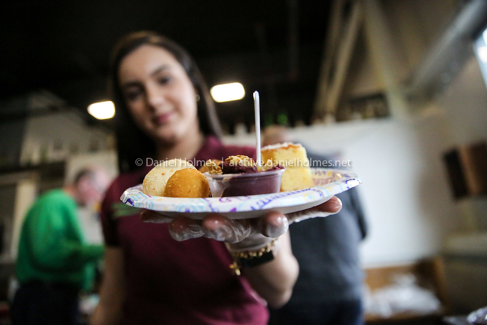 (4/28/19, FRAMINGHAM, MA) Sara Pontes of Miranda Bread at 470 Waverly St, serves up some treats during the 3rd Annual Taste of Downtown Framingham at the Springdale Barrel Room in Framingham on Sunday. [Daily News and Wicked Local Photo/Dan Holmes]