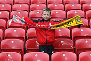 A young Liverpool fan looks on prior to kick off. Premier League match, Liverpool v Hull City at the Anfield stadium in Liverpool, Merseyside on Saturday 24th September 2016.<br /> pic by Chris Stading, Andrew Orchard sports photography.
