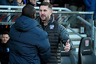 Bury manager Chris Lucketti greets his Northampton counterpart before the EFL Sky Bet League 1 match between Northampton Town and Bury at Sixfields Stadium, Northampton, England on 25 November 2017. Photo by Nigel Cole.