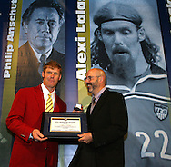 28 August 2006: Alexi Lalas (l) receives his Hall of Fame jacket, plaque, and ring from Hall of Fame president Will Lunn (r). The National Soccer Hall of Fame Induction Ceremony was held at the National Soccer Hall of Fame in Oneonta, New York.