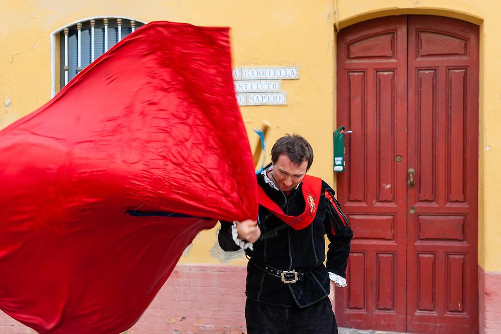 Tuna dancer with red cape in Sevilla (Spain)