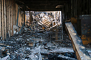 The burned interior of a Foot Locker shoe store in the Phillips neighborhood of Minneapolis, Minnesota on Monday, June 1, 2020. The store was completely destroyed during the civil unrest that overwhelmed the Twin Cities in the final days of May following the death of George Floyd at the hands of Minneapolis Police Department officers.